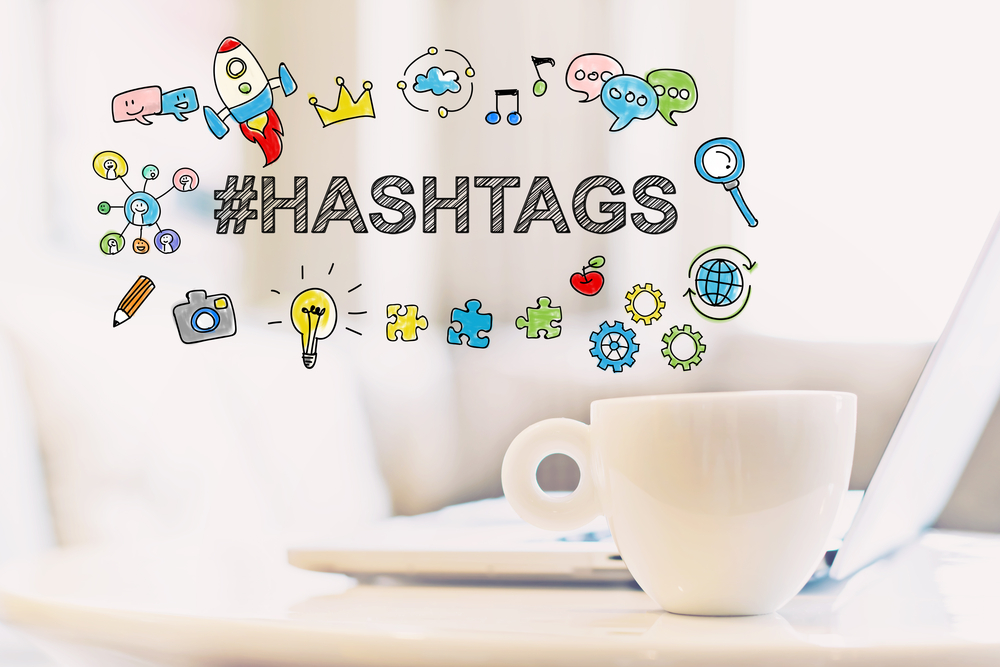 Hashtags concept with a cup of coffee and a laptop